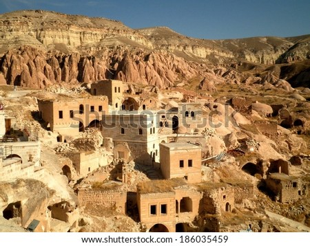 Scenic view of cave houses landscape in Cappadocia. - stock photo