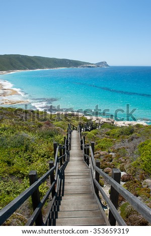 Scenic view of cliff coast and Cable Beach at Torndirrup National Park, Albany, Western Australia, wild Southern Ocean, blue sky, copy space. - stock photo