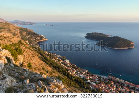 Scenic view of coastline and Lokrum Island from the Mount Srd in Dubrovnik, Croatia at sunset. - stock photo