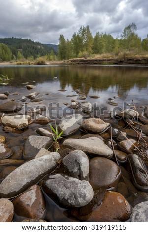 Scenic view of Coeur d'Alene river located in Cataldo, Idaho. - stock photo