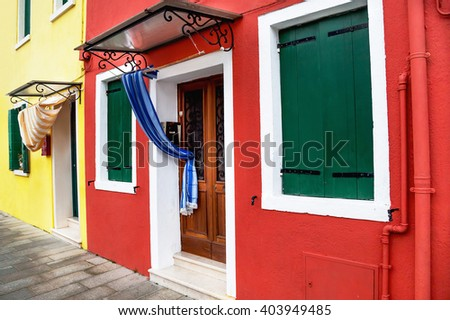 Scenic view of colored houses in the famous Burano island. Detail in Burano. Travel (vacation), architecture concept. Italy.  - stock photo