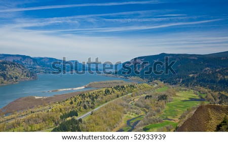 Scenic view of Columbia River Gorge receding under blue sky and cloudscape, Oregon, U.S.A. - stock photo