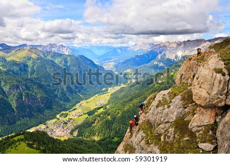 Scenic view of Dolomite valley with climbers on the rocks - stock photo