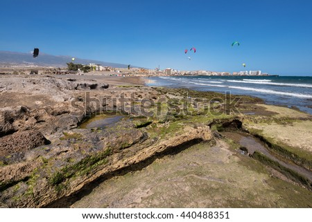 Scenic view of el Medano coastline, hotels and resorts in the background, Tenerife, Canary island, Spain. - stock photo