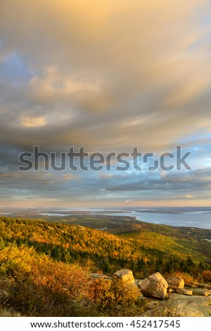 Scenic View of Fall Trees and Ocean Inlet with Colorful Morning Sky - stock photo