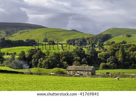 Scenic view of farm in countryside, Yorkshire Dales National Park, England. - stock photo