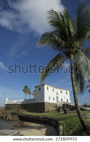 Scenic view of Fort Santa Maria in Barra Salvador Brazil tropical beach and palm trees - stock photo