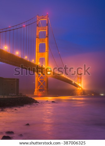 scenic view of Golden gate in the in the night with lighting and reflection on the water and fog,San Francisco,California,usa.