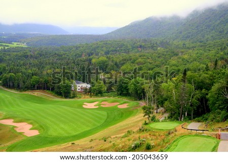 Scenic view of Golf Course with fog in distant valley - stock photo
