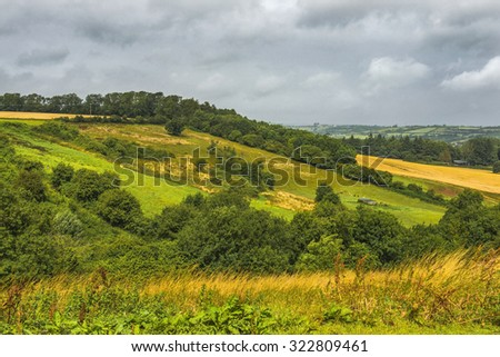 scenic view of green hills in the Saint Catherine's Valley Near the City of Bath in England - stock photo