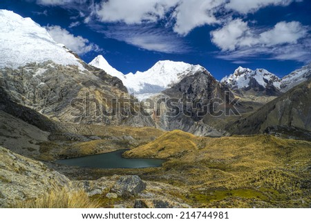Scenic view of high mountain peaks in Peruvian Andes - stock photo