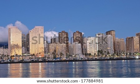 Scenic view of Honolulu city and harbor at night. - stock photo