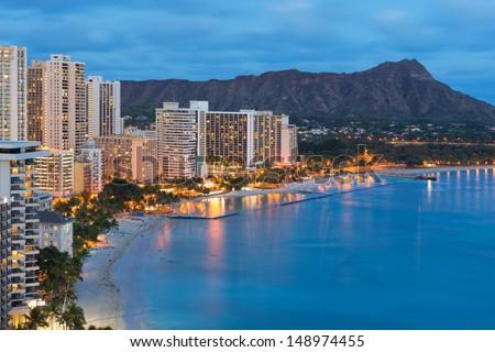 Scenic view of Honolulu city, Diamond Head and Waikiki Beach at night; Hawaii, USA - stock photo