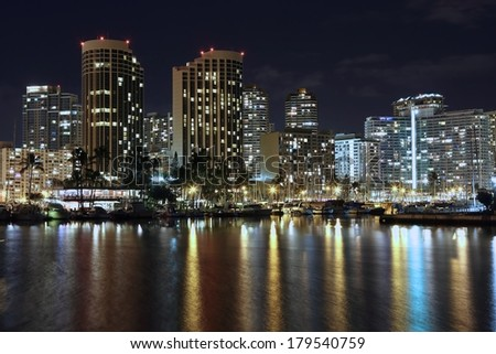 Scenic view of Honolulu city light up and Waikiki Beach water reflect beautiful light; Hawaii, USA