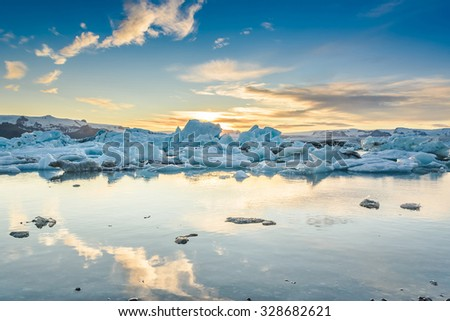Scenic view of icebergs in Jokulsarlon glacier lagoon, Iceland, at sunset, selective focus,  global warming and climate change concept - stock photo