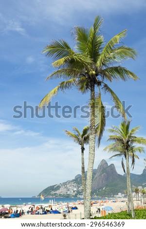 Scenic view of Ipanema Beach Rio de Janeiro Brazil with Two Brothers Mountain through palm trees - stock photo