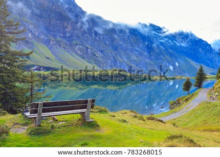 Scenic view of Lake Trubsee that lies at the foot of the Titlis, Engelberg, Switzerland. This is a mountain lake in the municipality of Wolfenschiessen in the Swiss canton of Nidwalden.