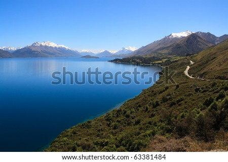 Scenic view of Lake Wakatipu with Southern Alps in background near Queenstown, South Island, New Zealand - stock photo