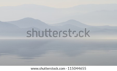 Scenic view of lake with mountain reflections - stock photo