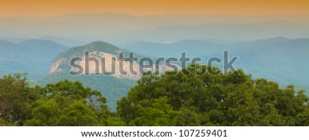 Scenic view of Looking Glass Rock in North Carolina with the Blue Ridge Mountains in the background. - stock photo