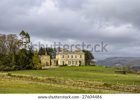 Scenic view of luxurious manor house on countryside estate, England - stock photo