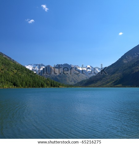 Scenic view of mountain lake - stock photo