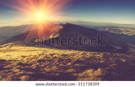 Scenic view of mountains, autumn landscape with colorful hills at sunset.Filtered image:cross processed vintage effect. - stock photo