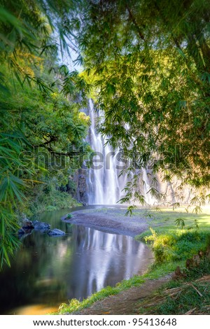 Scenic view of Niagara waterfall in picturesque forest with river in foreground, Reunion Island.