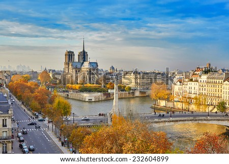 Scenic view of Notre-Dame de Paris with Saint-Louis and Cite islands on a bright fall day - stock photo