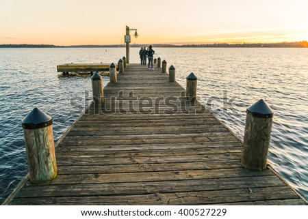 scenic view of pier in the sunset in lake washington,kirkland,Washington,usa. - stock photo