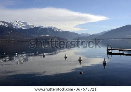 Scenic view of quiet blue Annecy lake landscape, in Savoy, france and mountains - stock photo