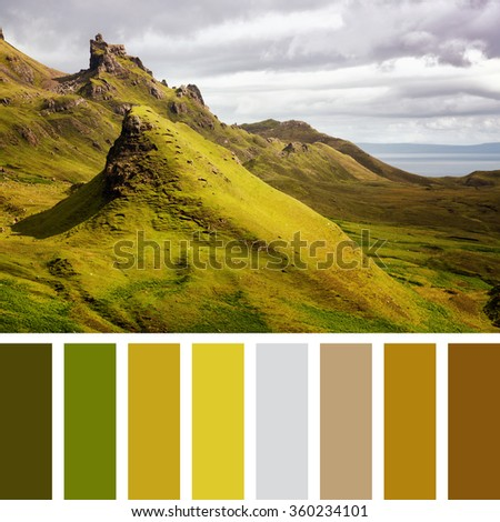 Scenic view of Quiraing mountains with dramatic sky in the Isle of Skye, Scottish highlands, United Kingdom In a colour palette with complimentary colour swatches. - stock photo