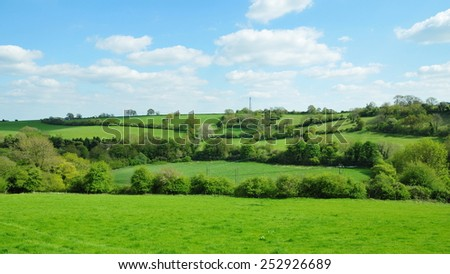 Scenic View of Rolling Countryside of Green Fields in the Avon Valley in Wiltshire England - stock photo