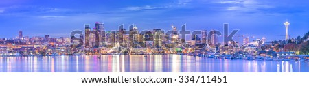 scenic view of Seattle city in the night time with reflection of the water,Seattle,Washington,USA. - stock photo