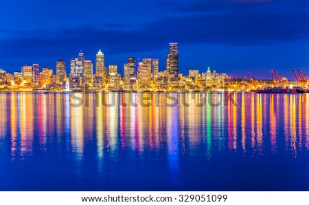 scenic view of Seattle skylines in blue hour from Alki Beach, West Seattle, Washington, USA. - stock photo