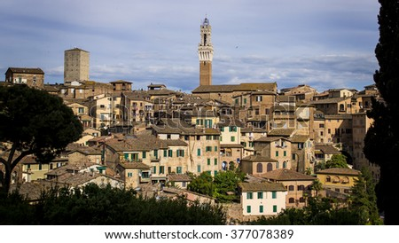 Scenic view of Siena houses and tower at sunset - stock photo