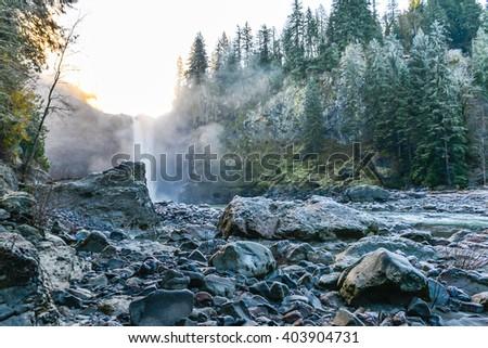 scenic view of Snoqualmie falls with golden fog when sunrise in winter season,Washington,USA. - stock photo