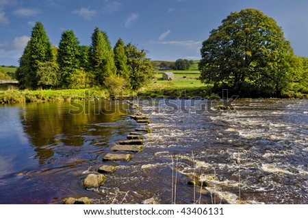 Scenic view of stepping stones across river Wharfe, Yorkshire Dales National Park, England. - stock photo