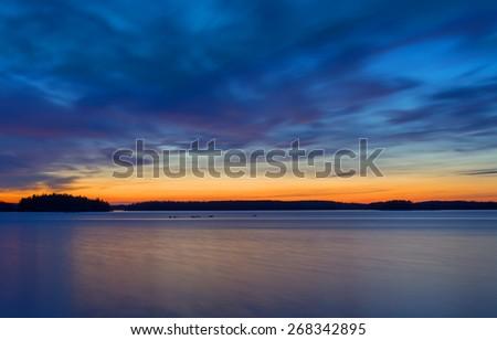 Scenic view of sunset lake - stock photo