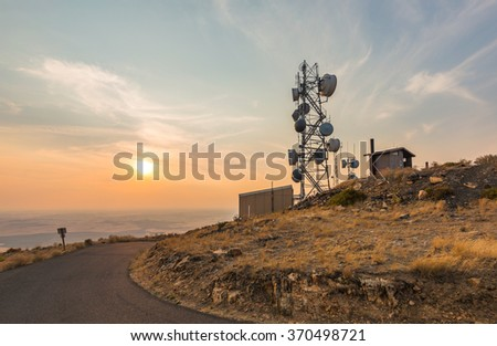 scenic view of  Telecommunication mast TV antennas  on the sunset. - stock photo