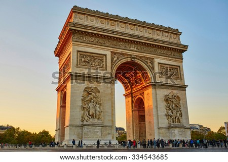 Scenic view of the Arch of Triumph at the evening in Paris, France - stock photo