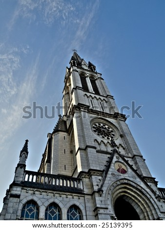 Scenic view of the Basilica of the Immaculate Conception in Lourdes with Pope Pius IX - stock photo