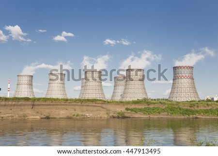 Scenic view of the big pipes of coolers near the power plant - stock photo