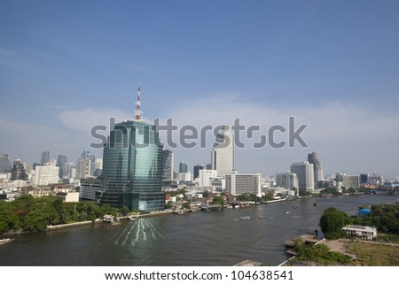 Scenic view of the Chao Praya River in Bangkok including barge and river taxi - stock photo