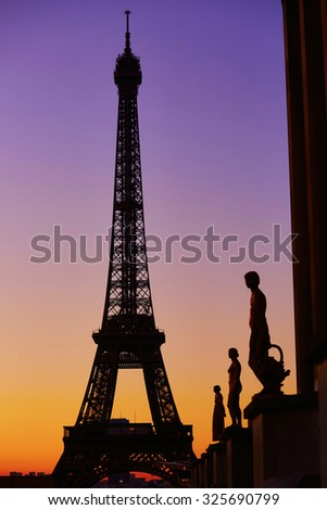 Scenic view of the Eiffel tower during sunrise, photo taken from Trocadero. Focus on the Eiffel tower - stock photo