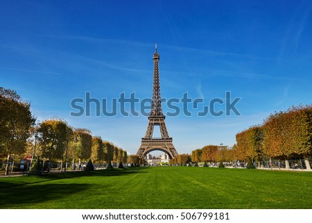 Scenic view of the Eiffel tower over blue sky. Sunny autumn day in Paris