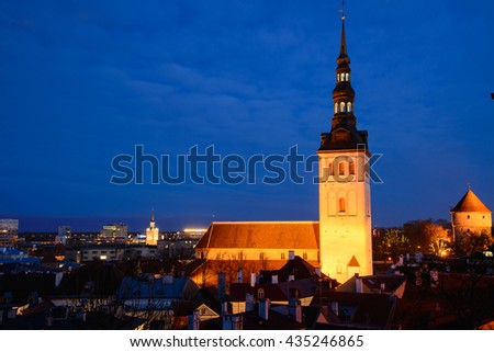 Scenic view of the old town city and sea port harbor in Tallinn, Estonia. Toompea hill with tower St. Olaf church and Russian Orthodox Alexander Nevsky Cathedral