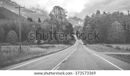 scenic view of the road in the  countryside. - stock photo