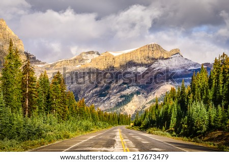 Scenic view of the road on Icefields parkway, Canadian Rockies, Jasper and Banff NP - stock photo
