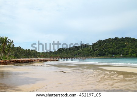 Scenic view of the tropical beach with palm trees and wooden bridge , Koh Kood island, Thailand